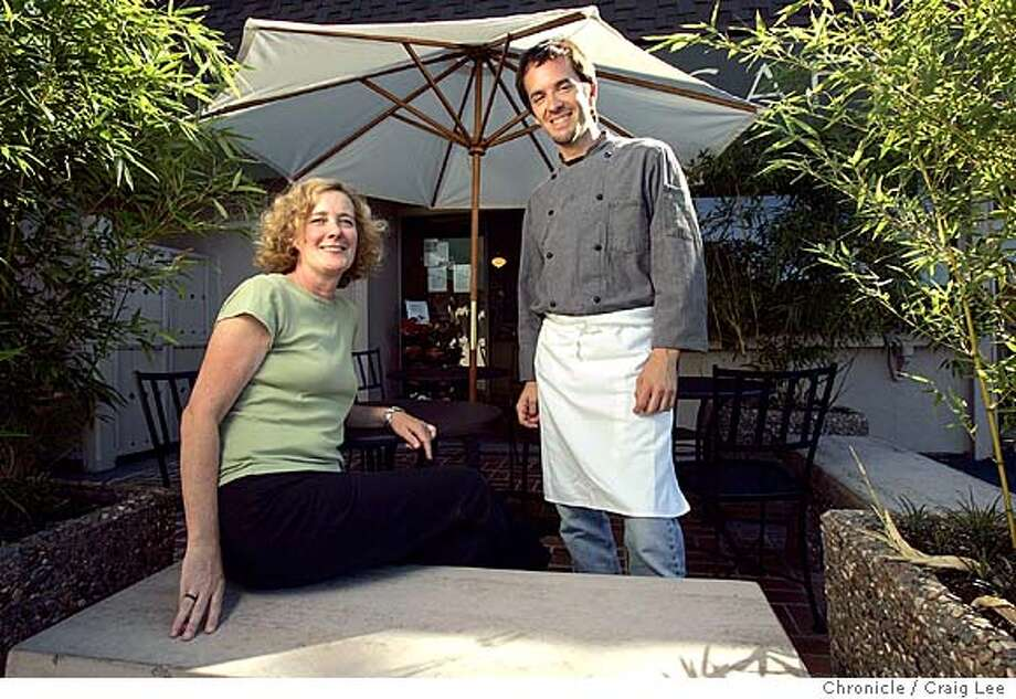 Suzanne McGoldrick (left) and Kyle Fehr (right) run Tabla Cafe restaurant in Larkspur. They created a pear recipe for the Seasonal Cook column.  Event on 9/1/04 in Larkspur. Craig Lee / The Chronicle Photo: Craig Lee
