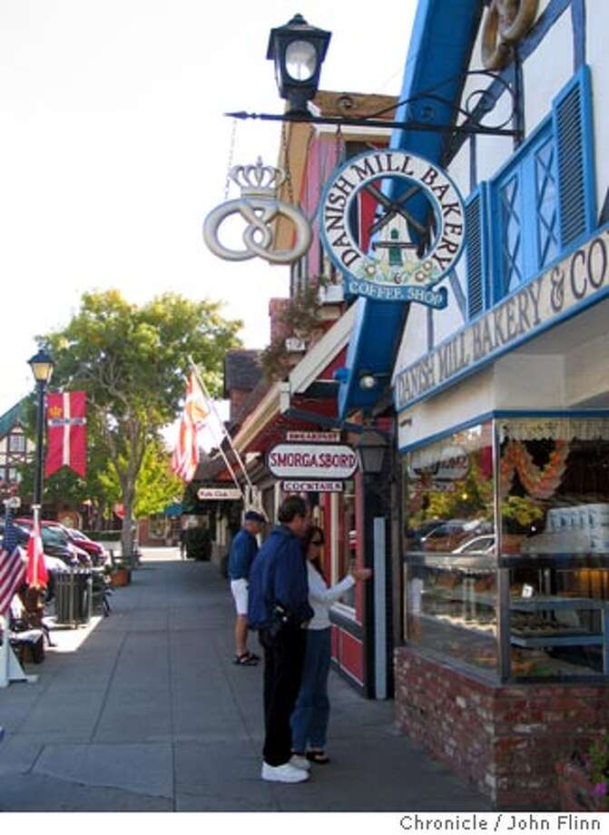 Travel Solvang -- in Solvang, US. John Flinn/The Chronicle Ran on: 02-27-2005  Half-timbered shops, bakeries and restaurants with a Danish theme line the streets of Solvang, above. Right: A statue of &quo;The Little Mermaid&quo; recalls both Hans Christian Andersen's tale and a similar icon in Copenhagen. Photo: John Flinn