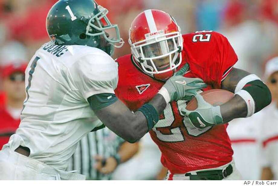 Georgia Southern's James Young, left, tries to bring down Georgia's Danny Ware during the seconed half of their game Saturday Sept. 4, 2004 at Sanford Stadium in Athens, GA. Ware rushed for 135 yards as Georgia won 48-28. (AP Photo/Rob Carr) Photo: ROB CARR