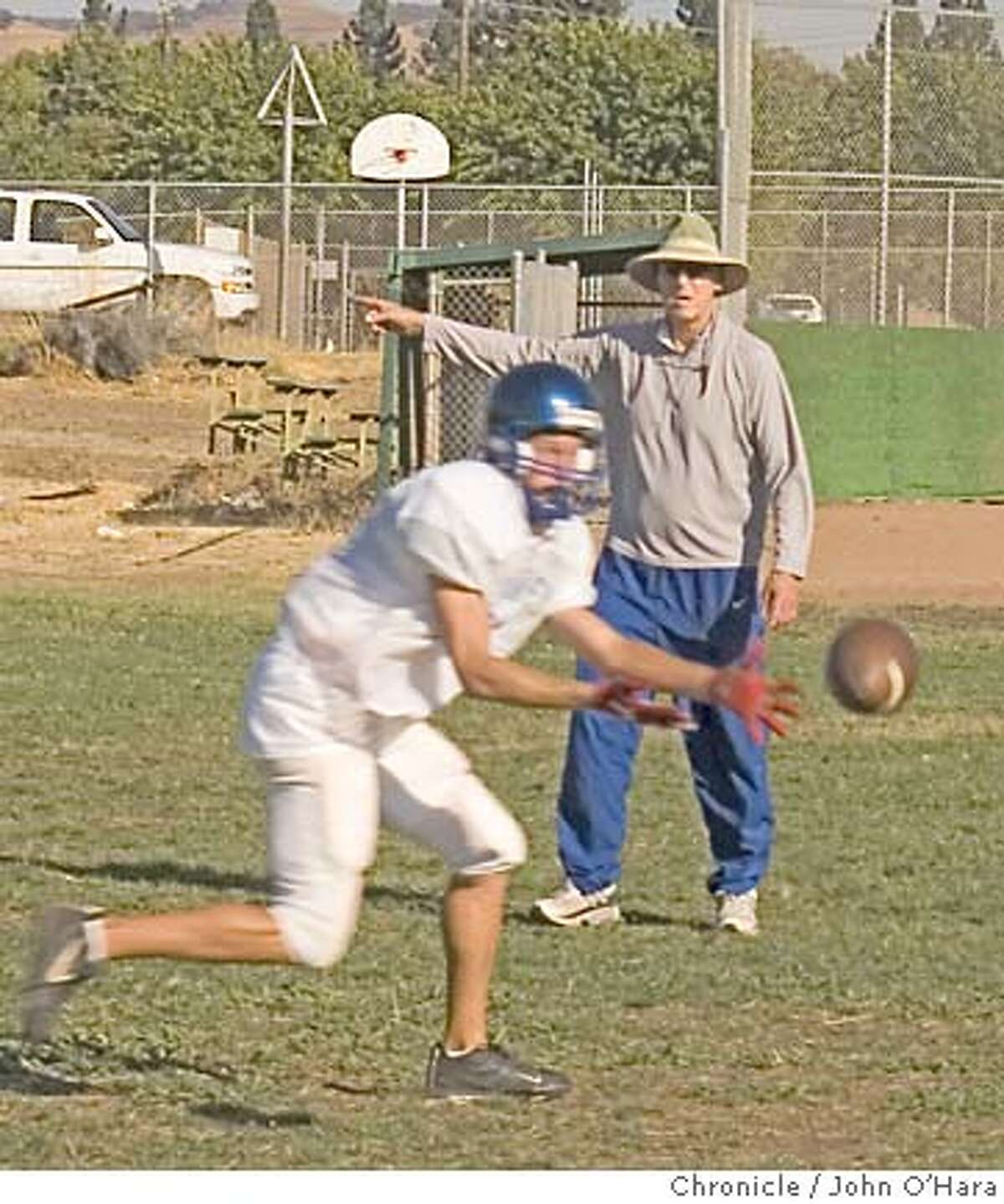 Clayton Valley High School. Jerry Coakley, a 67 year old defensive foot ball coach. A retired warrant officer in the US Marines, at 58 was recalled for the 1st gulf war. He works with Matt Grogan photo/John O'Hara