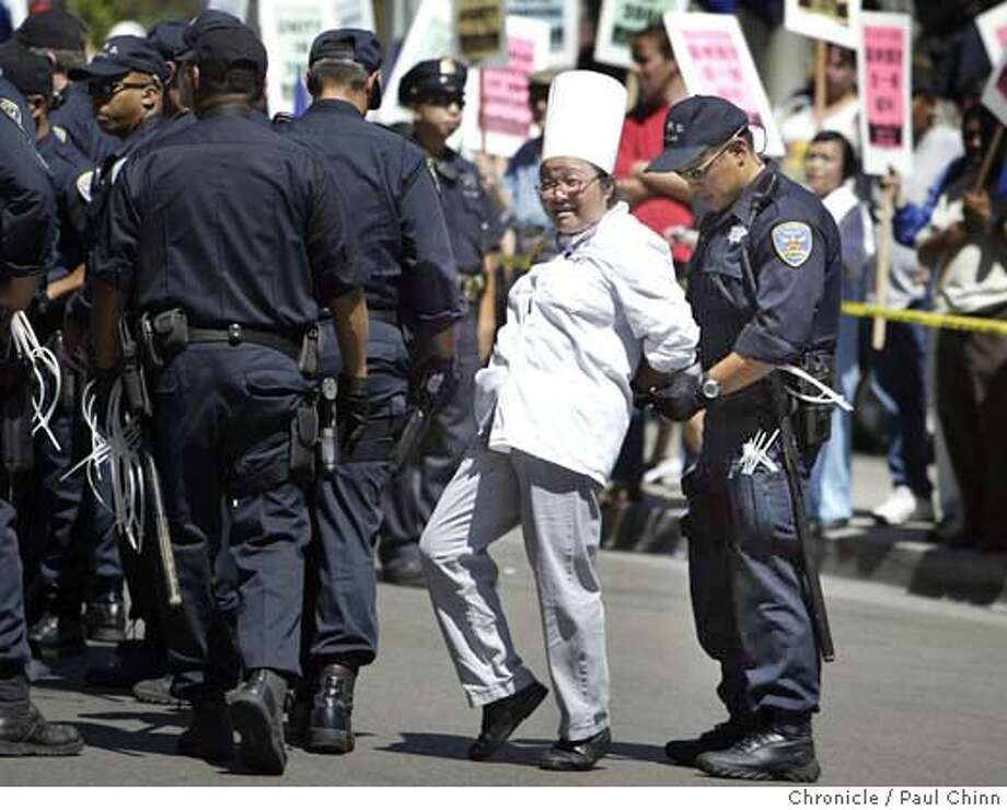 An unidentified hotel cook was among the 150 arrested for a sit-in on Powell St. About 150 hotel workers and union activists from SEIU Local 2 were arrested after sitting down on the cable car tracks in front of the St. Francis Hotel on 9/6/04 in San Francisco, CA. PAUL CHINN/The Chronicle Photo: PAUL CHINN
