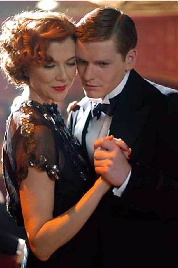 """BEING22_01.JPG Annette Bening as Julia Lambert and Shaun Evans as Tom Fennel in """"Being Julia."""" Alex Dukay / Sony Pictures Ran on: 10-22-2004  Annette Bening (left), playing an actress with an open marriage, has a fling with a younger man, played by Shaun Evans. Ran on: 11-15-2004  Good bets: Jamie Foxx in &quo;Ray,&quo; Annette Bening in &quo;Being Julia&quo; and Leonardo DiCaprio in &quo;The Aviator.'' Photo: Alex Dukay"""