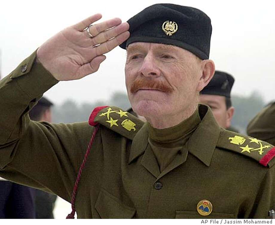 **FILE** Former Iraqi Vice Chairman of the Revolutionary Command Council, Izzat Ibrahim al-Douri, is seen during a cermony in Baghdad in this Dec. 1, 2002, file photo. Al-Douri, Saddam Hussein's former second-in-command, was arrested in northern Iraq, Saleh Sarhan, an Iraqi Defense Ministry spokesman told al-Hurra television. Sarhan said al-Douri was captured while in a clinic where he was receiving medical treatment. Al-Douri, who had a U.S. bounty of $10 million on his head, was the highest-ranking member of Saddam's government who was still at large. (AP Photo/Jassim Mohammed, File) Photo: JASSIM MOHAMMED