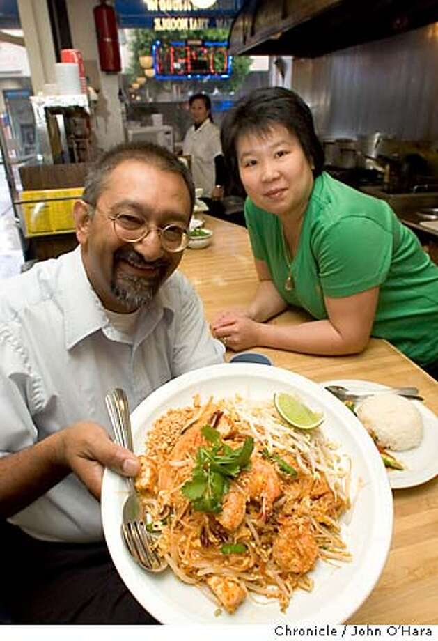 COOKSNIGHHTOUT27_017_OHARA.CR2  Siam Thai Noodle, 167 Mason St. San Francisco,CA  Ranjan Dey , owner of ther New Delhi Resturant on Ellis St. at his favorite resturant.  Nongnuch ramnandana ( green shirt, closest to Ranjan)  ( Walee Jirapornsirikul rear)  Pad Thai Noodle  photo/John O'Hara Photo: John O'Hara