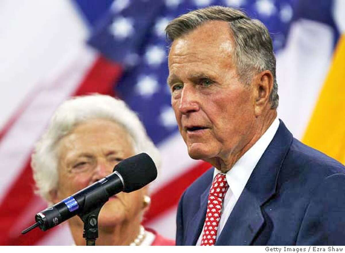 QUEENS, NY - AUGUST 30: Former President George H.W. Bush addresses the audience during the opening ceremony of the US Open at the USTA National Tennis Center in Flushing Meadows Corona Park on August 30, 2004 in the Flushing neighborhood of the Queens borough of New York. (Photo by Ezra Shaw/Getty Images) *** Local Caption *** George H.W. Bush