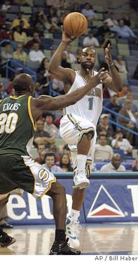 New Orleans Hornets' Baron Davis (1) heads to the basket around Seattle SuperSonics' Reggie Evans (30) during the first half in New Orleans on Wednesday night, Feb. 23, 2005. This is the first game Davis has played in after missing 17 games with an injured right Achilles' tendon. (AP Photo/Bill Haber) Photo: BILL HABER
