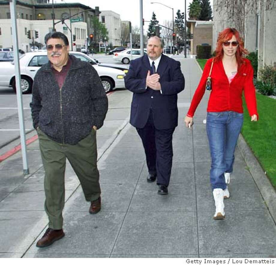 REDWOOD CITY, CA - FEBRAURY 25: Scott Peterson trial jurors Michael Belmessieri (L), John Guinasso (C) and Richelle Nice, arrive at the San Mateo County Superior Courthouse February 25, 2005 in Redwood City, California. Peterson, convicted of double-murder, is scheduled to be sentenced on March 16. (Photo by Lou Dematteis-Pool/Getty Images) *** Local Caption *** Michael Belmessieri;John Guinasso;Richelle Nice Photo: Pool