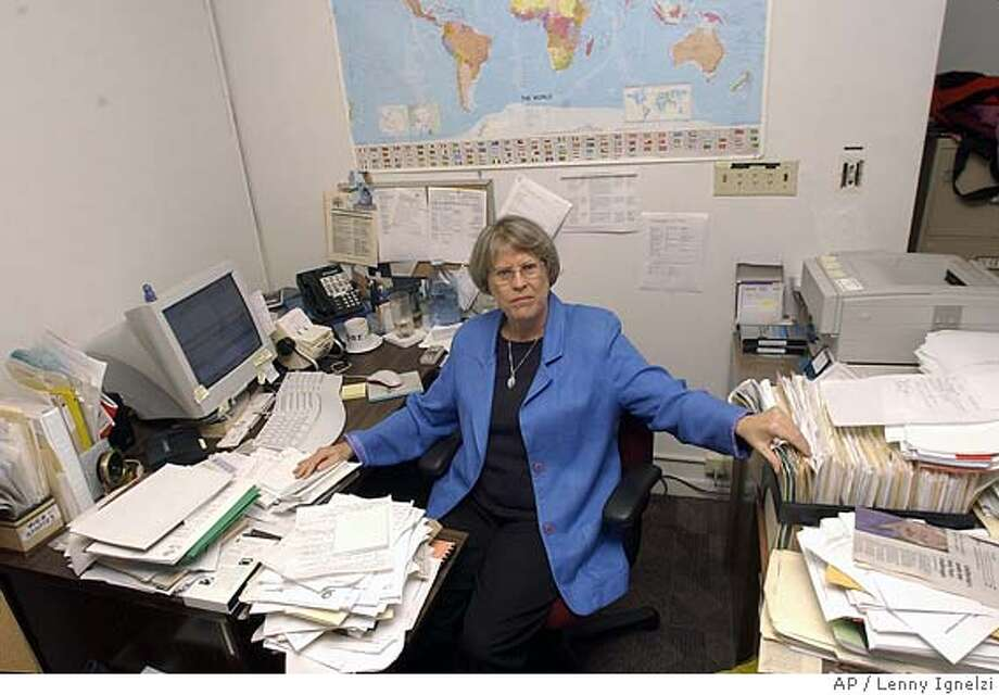 """** FOR USE IN YEAR-END EDITIONS WITH STORY SLUGGED YE PRIVACY CHALLENGE ** Beth Givens, the director of the Privacy Rights Clearinghouse, sits at her desk surrounded by files she refers to as """"her projects"""" Monday Dec. 8, 2003 in San Diego. """"I consider the issue of public records on the Internet to be one of the most challenging public policy issues of our time,"""" said Givens. (AP Photo/Lenny Ignelzi) Foreign#MainNews#Chronicle#12/12/2003#ALL#Advance#D11#0421524063 Privacy advocate Beth Givens calls public records on the Internet &quo;one of the most challenging public policy issues of our time.&quo; Nation#MainNews#Chronicle#12/12/2003#ALL#Advance#D11#0421524063 CAT Photo: LENNY IGNELZI"""