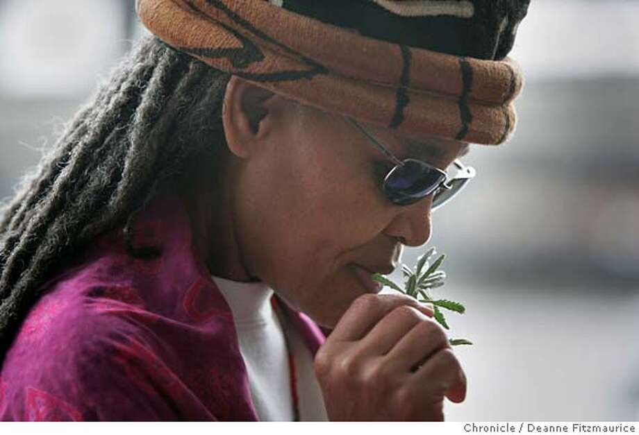 farmersmarket_167_df.JPG  Kanika Ajanaku enjoys the scent of a lavendar sprig. This Oakland Farmer's Market caters to the African-American community.  Deanne Fitzmaurice / The Chronicle Photo: Deanne Fitzmaurice