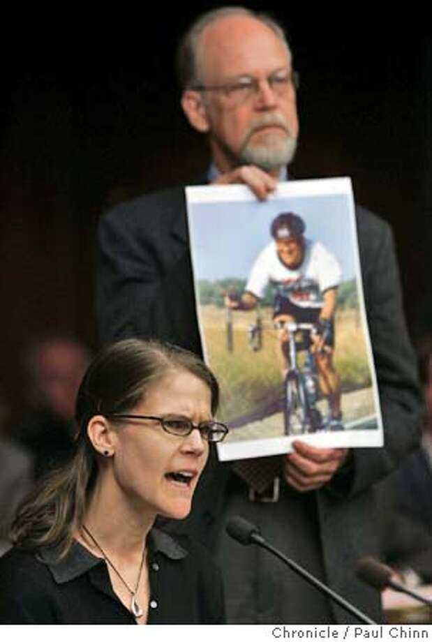 ryan25_129_pc.jpg  Sarah Cherny urged the directors to consider a suicide barrier which, she says, would have prevented her fiance Phil Holsten from jumping last October. Cherny's father Robert held a photo of Holsten while his daughter testified. Golden Gate Bridge directors hear public testimony from victims' families as they consider installing a suicide barrier on the bridge on 2/24/05 in San Francisco, CA. PAUL CHINN/The Chronicle MANDATORY CREDIT FOR PHOTOG AND S.F. CHRONICLE/ - MAGS OUT Photo: PAUL CHINN