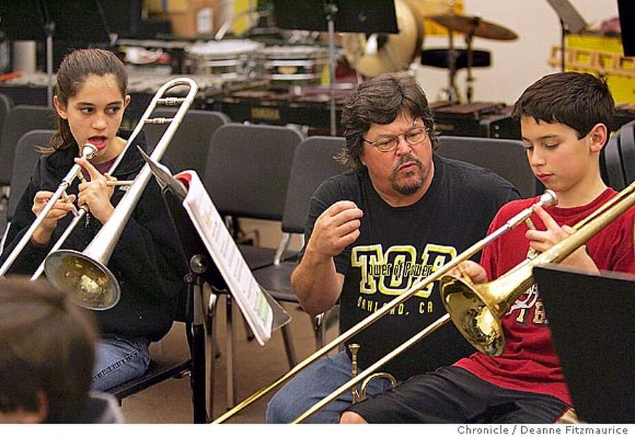 Mic Gillette (cq) former horn player with Tower of Power, works with trombone players, Maya Schechter, 7th grader, left, and Michael Leamy, 6th grader. He is assisting in the music department at Stanley Middle School in Lafayette.  Deanne Fitzmaurice / Photo: Deanne Fitzmaurice