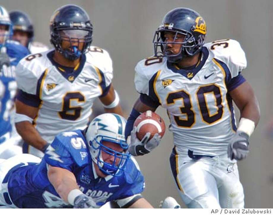California tailback J.J. Arington, front right, runs past Air Force linebacker Kenny Smith, front left, as California wide receiver Geoff McArthur, back, looks on as Arington breaks a run for a long gain to set up a touchdown in the second quarter of a non-conference contest in Falcon Stadium at Air Force Academy, Colo., on Saturday, Sept. 4, 2004. (AP Photo/David Zalubowski) Photo: DAVID ZALUBOWSKI