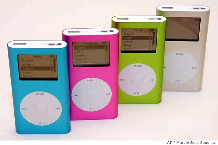 Apple's new line of iPod minis ae seen at the Apple Store in Palo Alto, Calif. on Wednesday, Feb. 23, 2005. Apple unveiled the second generation iPod mini lineup Wednesday with a new 4GB model priced at $199 and a new 6GB model priced at $249.(AP Photo/Marcio Jose Sanchez) Photo: MARCIO JOSE SANCHEZ
