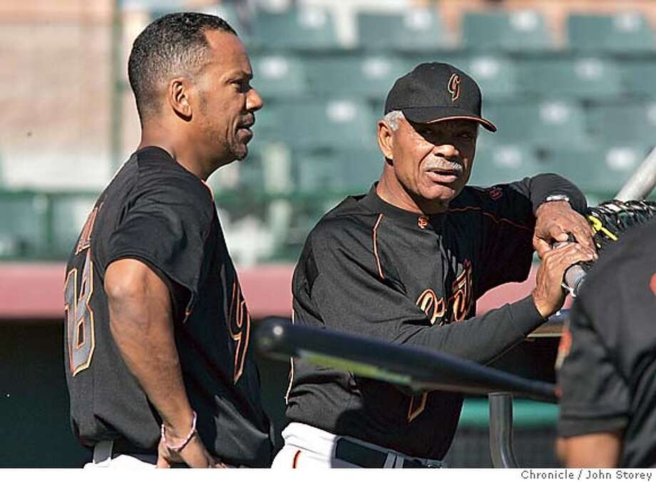 022305_Giants_jrs270.JPG  Giants right fielder Moises Alou talks with his father Felipe Alou. The Giants first full squad workout at Scottsdale Stadium during Spring Training.  Event on 2/23/05 in Scottsdale. John Storey / The Chronicle MANDATORY CREDIT FOR PHOTOG AND SF CHRONICLE/ -MAGS OUT Photo: John Storey