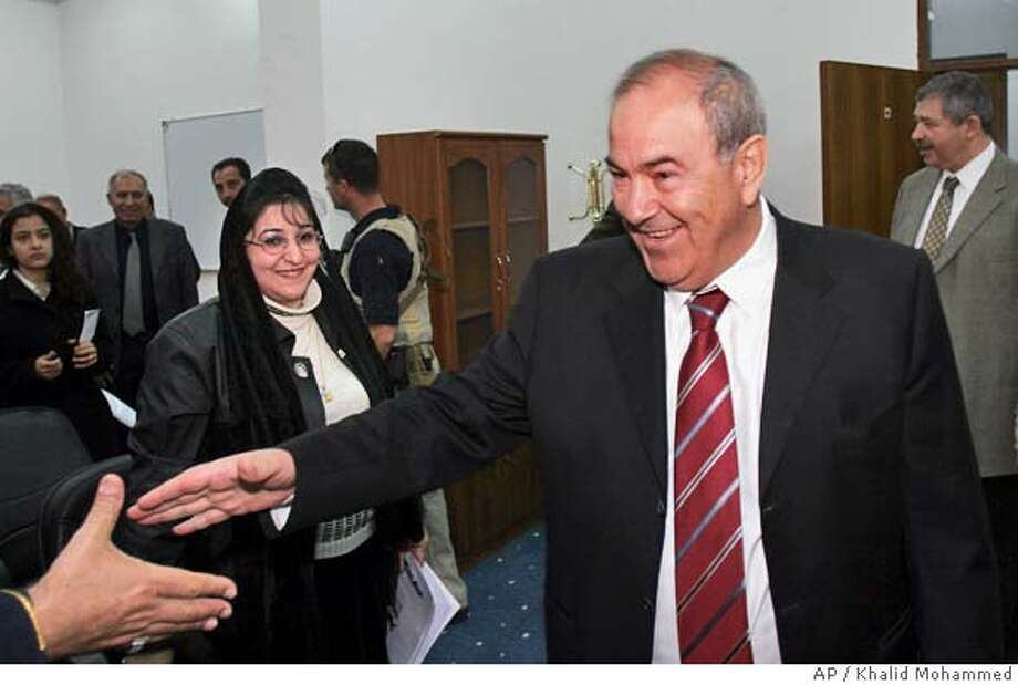 Iraqi Interim Prime Minister Ayad Allawi, right, greets supporters after a press conference at the headquarters of his Iraqi National Accord party in central Baghdad, Iraq Wednesday, Feb. 23, 2005. (AP Photo/Khalid Mohammed) Photo: KHALID MOHAMMED