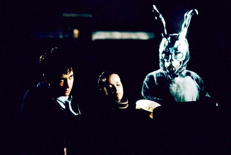 "Jake Gyllenhaal and Jena Malone and ""Frank"" in Donnie Darko Ran on: 08-29-2004  Jake Gyllenhaal, Jena Malone and the giant talking rabbit in Richard Kelly's &quo;Donnie Darko.&quo;"