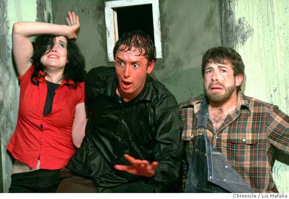 """EVIL24_103_LH.JPG left to right--Shannon Lark as Annie, Robert Selander starring as Ash, and Tom Dresner as Jake in a play Off Market Studio called """"Evil Dead: Live"""" which follows the story of Ash as he unknowingly unleashes the dark powers of the Necromonicon and must battle zombies and demons from hell to save his soul. Shot in San Francisco on 2/18/05. Creditted to San Francisco Chronicle/ Photo: Liz Hafalia"""
