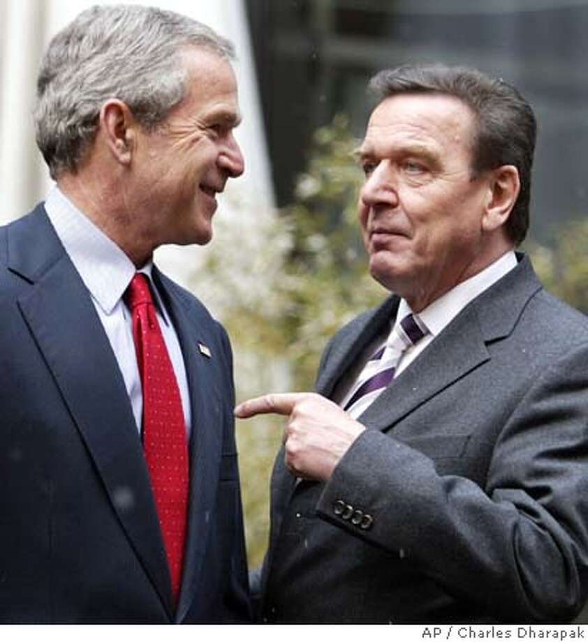 U.S. President Bush, left, and German Chancellor Gerhard Schroeder bid each other farewell after a visit to the Gutenberg Museum in Mainz, Germany, Wednesday, Feb. 23, 2005. (AP Photo/Charles Dharapak) Photo: CHARLES DHARAPAK