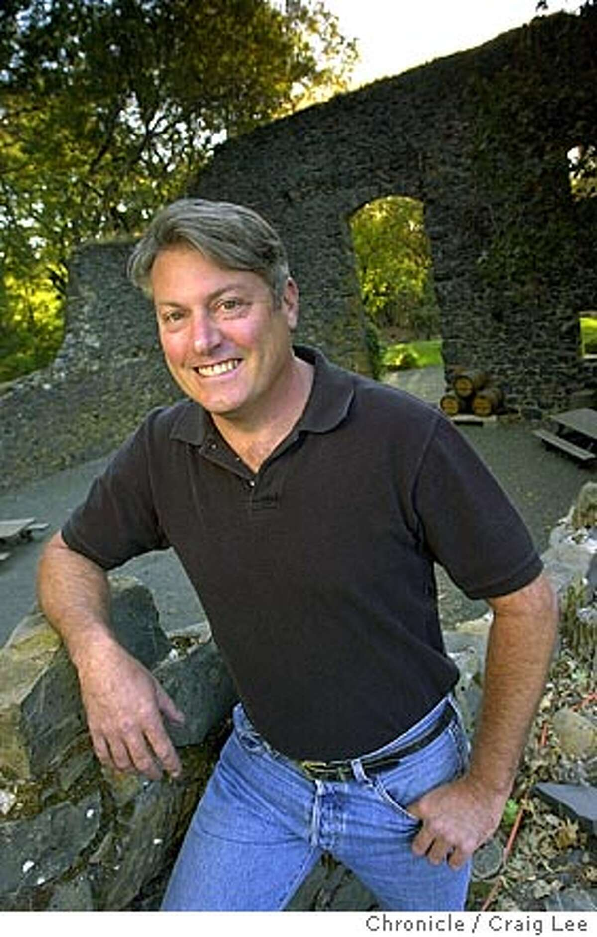Winemaker to watch. Bob Foley, winemaker at Pride Mountain Vineyards in St. Helena. The ruins behind him are the ruins of the Summit Ranch Winery that was built in 1890 but burned down in the 1920's during the prohibition era. Event on 10/29/03 in St. Helena. CRAIG LEE / The Chronicle