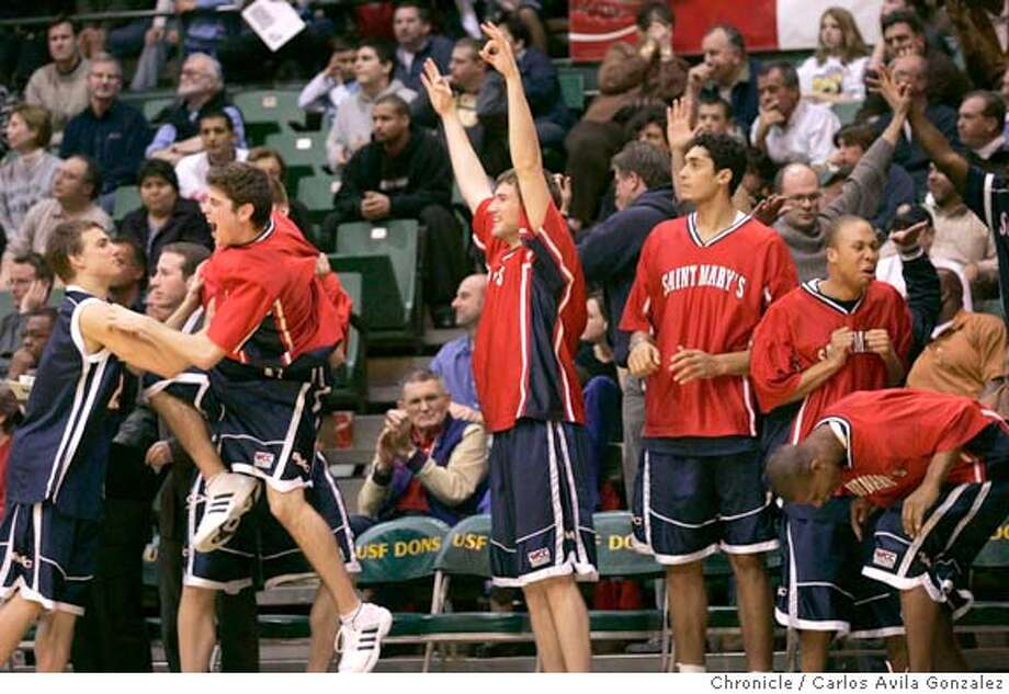 The Saint Mary's College Gaels bench reacts to a shot that put them ahead against the USF Dons in Triple overtime at Memorial Gymnasium in San Francisco, Ca., on Thursday, February 24, 2005.  Photo by Carlos Avila Gonzalez / The San Francisco Chronicle  Photo taken on 2/24/05 in San Francisco, CA. Photo: Carlos Avila Gonzalez