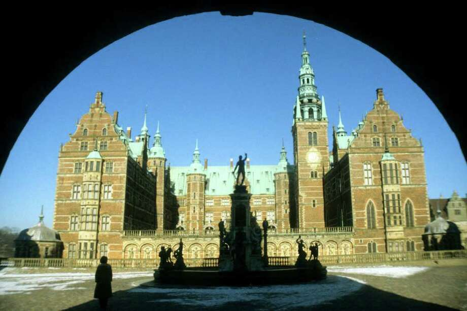 Walking up to Frederiksborg Castle, you can almost hear the clopping of royal hooves as you pass over several moats. Photo: David C. Hoerlein, Ricksteves.com