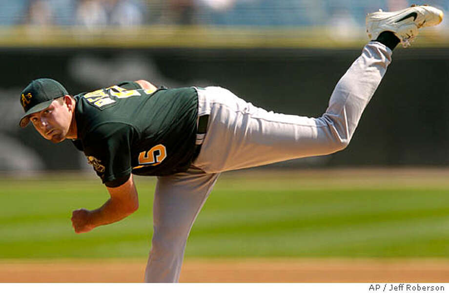 Oakland Athletics starting pitcher Mark Redman throws during the first inning against the Chicago White Sox Thursday, Sept. 2, 2004 in Chicago. (AP Photo/Jeff Roberson) Photo: JEFF ROBERSON