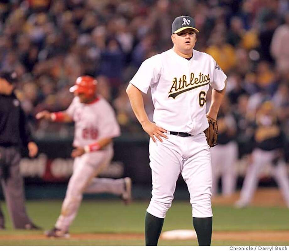 athletics02_007_db.jpg  Oakland Athletics pitcher Joe Blanton (64) is stunned after giving up a grand slam home run in the sixth inning vs. Anaheim Angels at Oakland. 10/1/04 in Oakland  Darryl Bush / The Chronicle MANDATORY CREDIT FOR PHOTOG AND SF CHRONICLE/ -MAGS OUT Photo: Darryl Bush