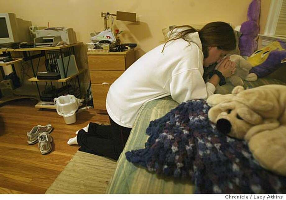 Christina Brown finishes her day kneeling beside her bed to pray, Aug. 9, 2004, at the Catherine's Center. She has gained strength to stay clean though God. Christina Brown, one of five women who live in Catherine's Center, a St. Vincent de Paul Society program for ex-convicts living in the rehab, Aug. 9, 2004, in Daly City. LACY ATKINS / The Chronicle Photo: LACY ATKINS