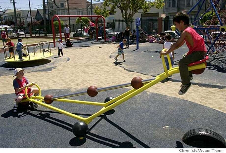 Matthew Scibetta, 9, left, and Isiah Escobar, 6, play at Parque Ninos Unidos is a new playground in the Mission district at the corner of Treat and 23rd was a dump site before the renovation. Photo by Adam Traum Photo: Adam Traum