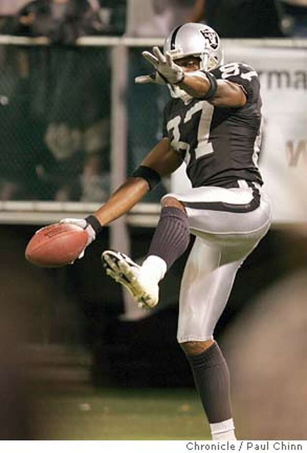Raiders WR Alvis Whitted dances in the end zone after scoring the winning touchdown with :38 seconds left in the game. The Raiders beat the Rams 28-24. Pre-season game between the Oakland Raiders vs. St. Louis at Network Associates Coliseum on 9/2/04 in Oakland. PAUL CHINN/The Chronicle Photo: PAUL CHINN