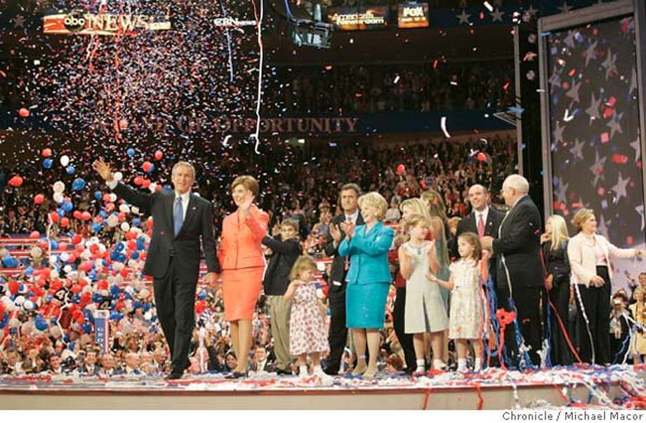 The President and Mrs. Bush take a tour around the stage at the conclusion of the Convention, family members from the Cheney and Bush families, crowd the stage. Day Four President George W. Bush accepts the Republican nomination for President of the United States. of the convention. The Republican National Convention, Madison Square Garden New York City. on 9/2/04. Michael Macor / San Francisco Chronicle Photo: Michael Macor