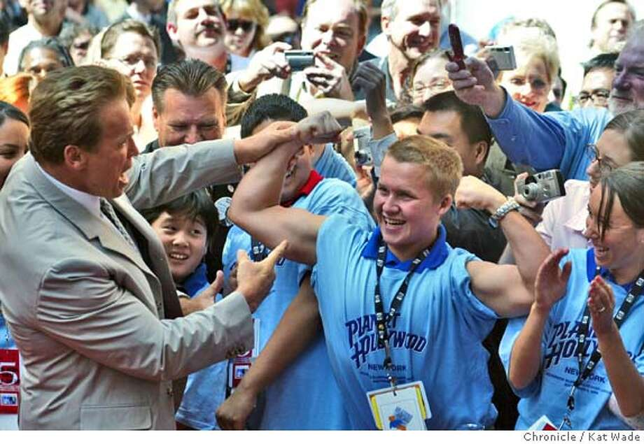 On 9/2/04 in New York, Junior California Delegate Alexander Porda flexes his muscles for California Governor Arnold Schwarzenegger (Left) as his enters Planet Hollywood in Times Square for the California Delegation Breakfast on the final day of the Republican National Convention in New York. (LEFT TO RIGHT) Arnold Schwarzenegger, jr. delegate Alexander Kil, jr. Delegate Alexander Porada and jr. Delegate Rebekah (CQ) Runner.  The Chronicle/ Kat Wade Photo: Kat Wade