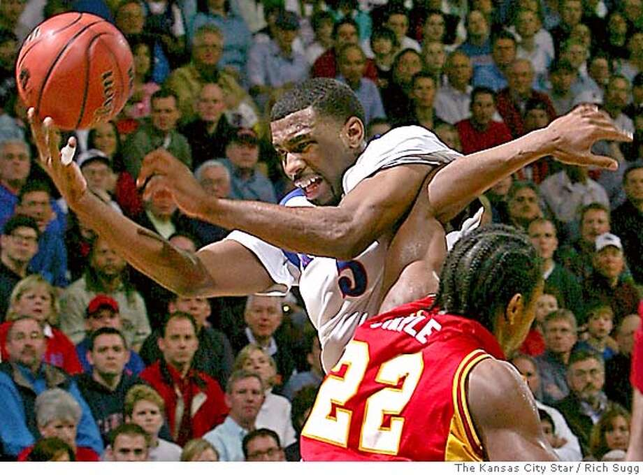 RICH SUGG/The Kansas City STar_02182005_Damion Staple (22) and the rest of the Iowa State Cyclones put the hurt on Keith Langford and the KU Jayhawks Saturday, winning 63-61 in overtime at Allen Fieldhouse. Photo: RichSugg