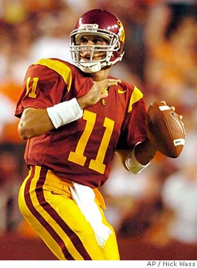 ** ADVANCE FOR WEEKEND EDITONS, SEPT. 4-5 ** Southern California quarterback Matt Leinart (11) looks to pass against Virginia Tech during USC's 24-13 win, Saturday, Aug. 28, 2004, in Landover, Md. Leinart went from untested sophomore to star quarterback last season, leading Southern California to a share of the national championship and finishing sixth in the Heisman Trophy voting.(AP Photo/Nick Wass) ** ADVANCE FOR WEEKEND EDITONS, SEPT. 4-5 ** Photo: NICK WASS