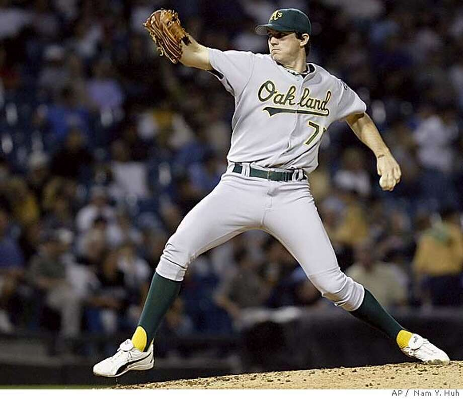 Oakland Athletics' pitcher Barry Zito delivers a pitch against the Chicago White Sox in the first inning, Wednesday, Sept. 1, 2004, in Chicago. (AP Photo/ Nam Y. Huh) Photo: NAM Y HUH