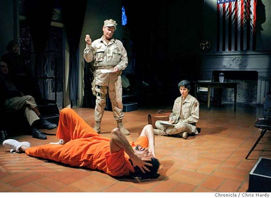 "enemy22_ch_070.jpg  ""En""Enemy Combatant,"" Central Works' new play based on the John Walker Lindh case. Marvin Samuel Moorhouse, the prisoner, (David Alan Moss), Col. Kaye (Keith Cox) and Capt Radcliff (Jan Zvaifler) . in Berkeley  2/20/05 Chris Hardy / San Francisco Chronicle Photo: Chris Hardy"