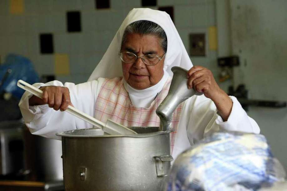 Cristina Botello prepares lunch along with other members of the Hermanas Josefinas at Assumption Seminary on Tuesday Jan. 24, 2012.  The order has served at Assumption Seminary for 60 years. The religious order, based in Mexico City, has provided sisters to cook and housekeeping for the seminarians since 1952. That relationship is coming to an end since most of the sisters are elderly and nearing retirement. Photo: HELEN L. MONTOYA, San Antonio Express-News / ©SAN ANTONIO EXPRESS-NEWS