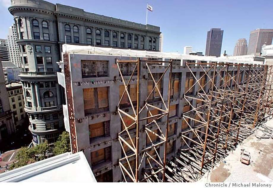 Steel girders support the brick facade of the old Emporium facing Market Street (across the street from the James C. Flood Building, seen in upper left). Developers of an expanded Westfield San Francisco Centre are preserving the facade and the historic dome, but preservationists say they failed to retain the front 65 feet of the original Emporium structure on Market as required. The developers agree that portion of the structure is gone, but they say they have met their legal requirements. The new 1.5 million square-foot, $410 million project will feature Bloomingdale's, a mix of 200 specialty stores, dining establishments, an international gourmet marketplace, office space and a nine screen auditorium complex. The project is scheduled to open in 2006  Photo by Michael Maloney / San Francisco Chronicle BLOOMIES_151_MJM.jpg  Steel girders support the brick facade of the old Emporium facing Market Street (across the street from the James C. Flood Building, seen in upper left). The facade will remain as will the historic dome.  Construction of Bloomingdale's, part of the expanded Westfield San Francisco Centre continues as the last part of the old Emporium building is set to be demolished. The brick facade (facing Market Street) and the 100 foot wide historic dome will be all that remains of the old Emporium as the new store is built beneath and around them. The new 1.5 million square-foot, $410 million project will feature a mix of 200 specialty stores, dining establishments, an international gourmet marketplace, office space and a nine screen auditorium complex. The project is scheduled to open in 2006  Photo by Michael Maloney / San Francisco Chronicle Ran on: 08-10-2004  Photo caption Ran on: 08-10-2004  Photo caption Ran on: 09-02-2004  The first si Photo: Michael Maloney