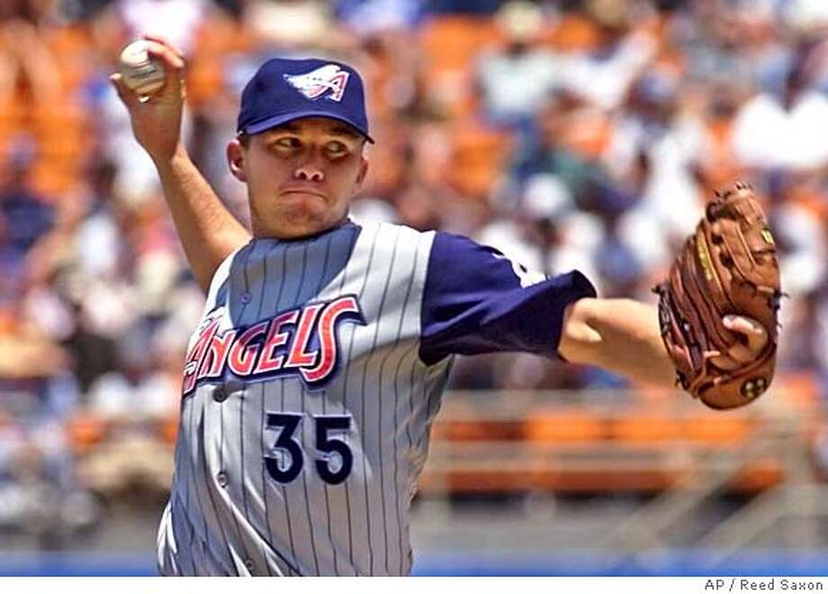 Anaheim Angels' pitcher Seth Etherton delivers a pitch against the Los Angeles Dodgers in the first inning Saturday, July 15, 2000, at Dodger Stadium in Los Angeles. Etherton recorded the win as the Angels defeated the Dodgers 6-2. (AP Photo/Reed Saxon) Photo: REED SAXON