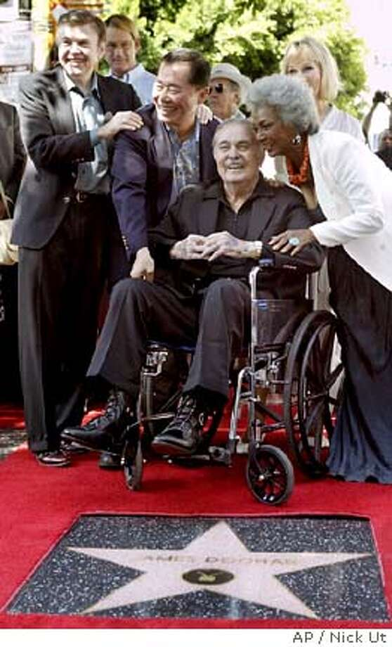 James Doohan, known best for his role as chief engineer Scotty (Montgomery Scott) aboard the U.S.S Enterprise in the original Star Trek television series and seven films, poses with former cast members, from left, Walter Koenig, George Takei and Nichelle Nichols while he accepts his star on the Hollywood Walk of Fame in Los Angeles Tuesday, Aug. 31, 2004. The 84-year-old Canadian suffers from Alzheimer's and Parkinson's disease, diabetes and lung fibrosis. (AP Photo/Nick Ut) Photo: NICK UT