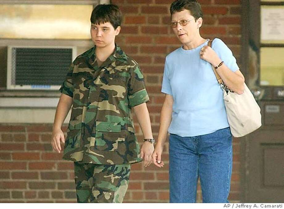 U.S. Army Pfc. Lynndie England walks with her mother, Terrie England, outside of the XVIII Airborne Corps Judge Advocate Building, Tuesday, Aug. 31, 2004, at Fort Bragg, N.C. England was appearing for an Article 32 hearing on charges of abusing Iraqi detainees and possession of sexually explicit photos not involving detainees. (AP Photo/Jeffrey A. Camarati) Photo: JEFFREY A. CAMARATI