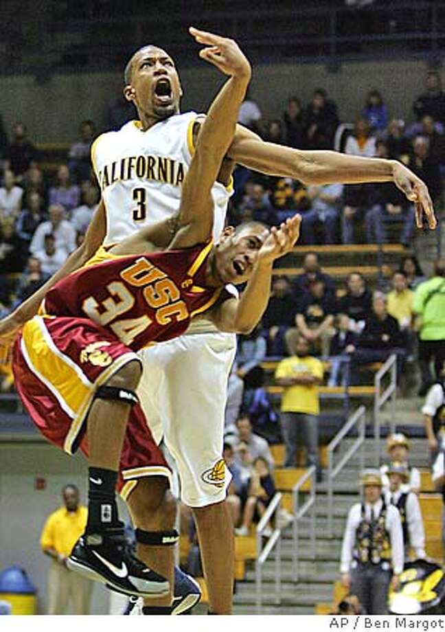California's Omar Wilkes (3) fouls Southern California's Gabriel Pruitt in the first half Saturday, Feb. 19, 2005, in Berkeley, Calif. (AP Photo/Ben Margot) Photo: BEN MARGOT