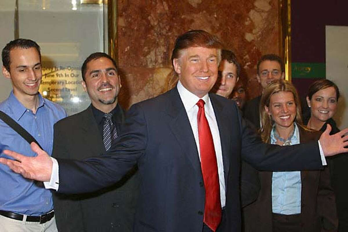 """**FILE** Donald Trump poses with prospective contestants during an audition for NBC's reality series """"The Apprentice,"""" in this undated publicity photo. The real estate titan is coming out with a new book. """"How to Get Rich'' will be published by Random House in April, coinciding with the live finale of """"The Apprentice.'' In """"The Apprentice,'' which debuted earlier this month, would-be moguls vie for Trump's favor and """"the dream job of a lifetime'' as his yearlong protege. (AP Photo/NBC, Eric Liebowitz)"""