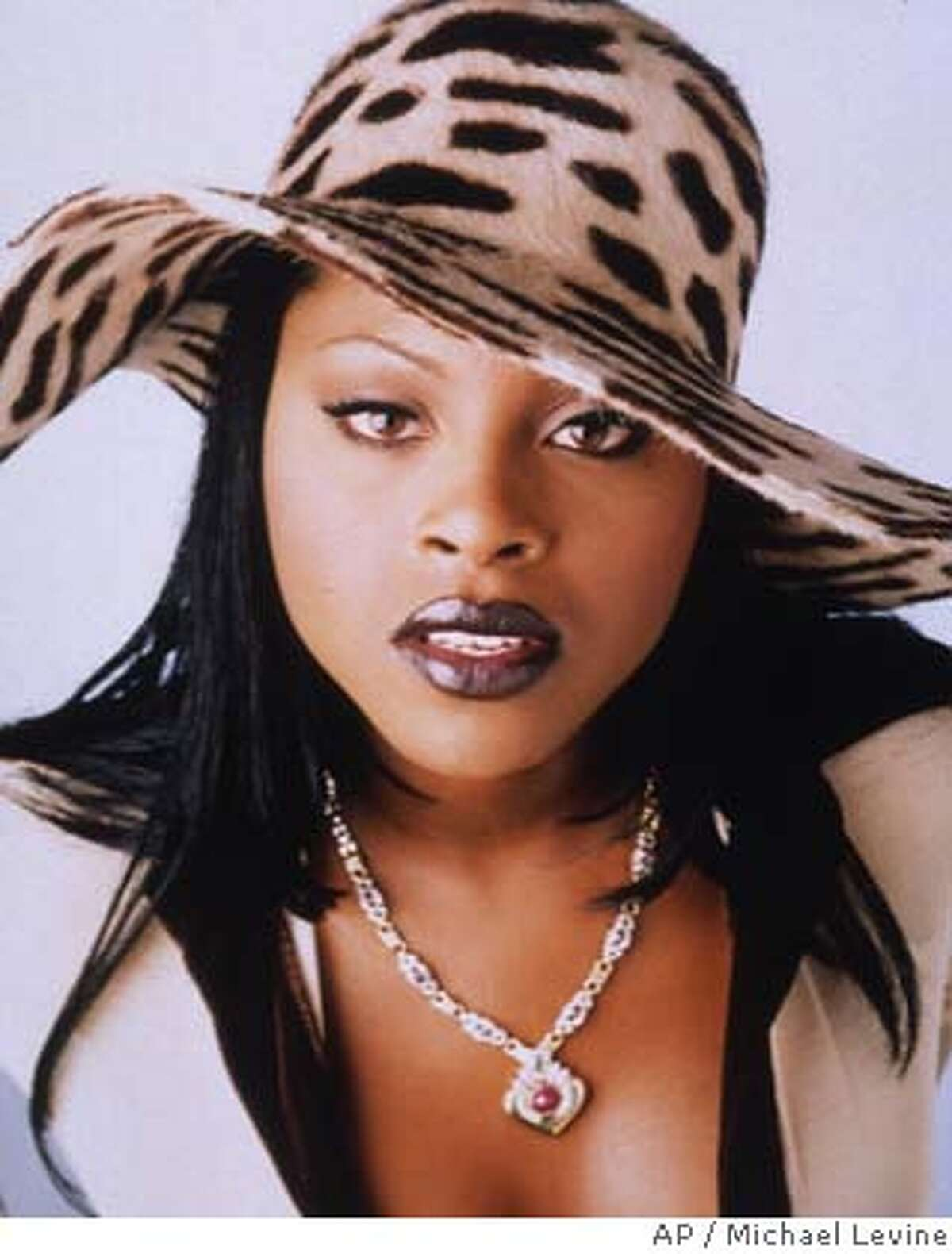 """ADV. FOR WKD. EDS., FEB. 21-23--Rapper Foxy Brown, 17, whose real name is Inga Marchand, became a rap sensation in 1996 as she made sizzling cameos on some of the year's biggest hits, such as Case's """"Touch Me, Tease Me,"""" and Toni Braxton's remix of """"You're Makin' Me High."""" Her first album, """"Il NaNa,"""" debuted this fall. (AP Photo/Michael Levine)"""