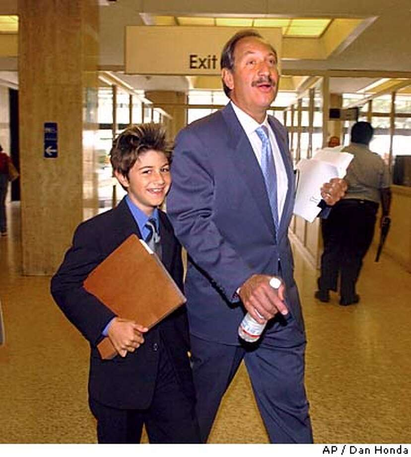Scott Peterson's defense attorney Mark Geragos and his 10-year-old son, Jake, enter the San Mateo County Courthouse in Redwood City, Calif. on Tuesday, Aug.t 31, 2004. Scott Peterson is on trial for the murder of his wife, Laci, and their unborn son in December of 2002. (AP Photo/Dan Honda, Pool) POOL PHOTO Photo: DAN HONDA
