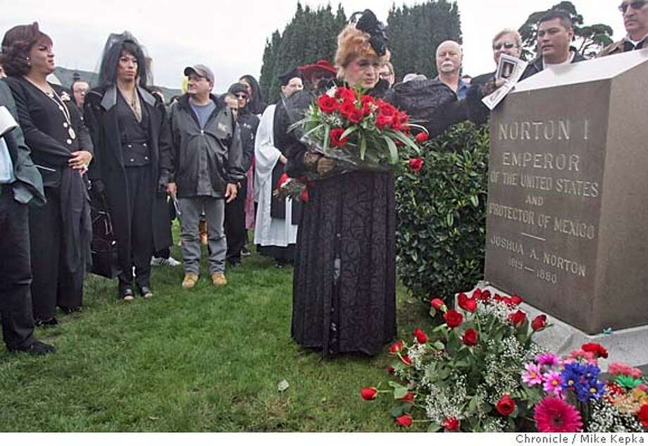 "norton21080_mk.jpg  On her last day as current Empress, Empress of Nortini, Jose Sarria, pays respect to Emperor Norton I at his grave site in the Woodlawn Cemetery in Colma.  Emperor Norton I, San Francisco's self-proclaimed monarch of the United States and beloved ""protector of the Mexico,"" is back in the limelight 125 years after his death with a memorial at the Woodlawn Cemetery where he is burried.  Mike Kepka / The Chronicle MANDATORY CREDIT FOR PHOTOG AND SF CHRONICLE/ -MAGS OUT Photo: Mike Kepka"