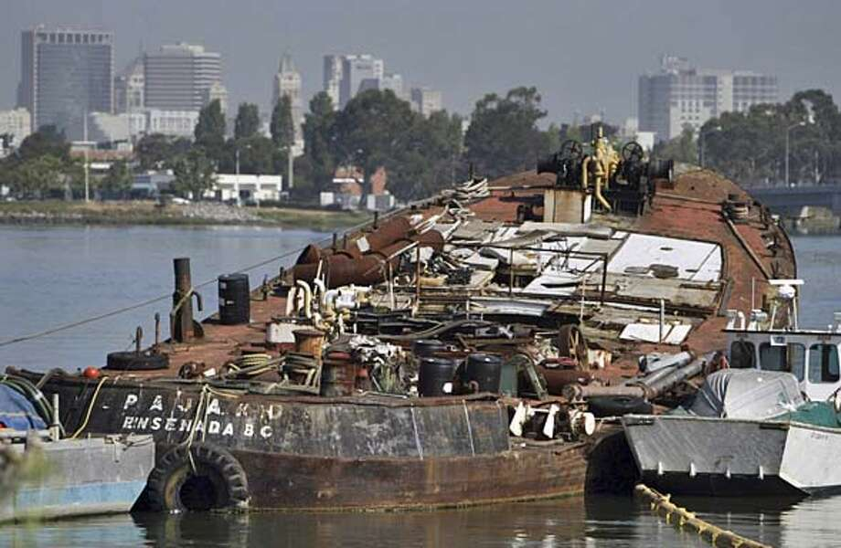 "cwpajaro_003_pc.jpg FOR CHRONWATCH: Abandoned boats in Alameda :The ""Pajaro-Ensenada, BC"" partially sunken boat on the Alameda estuary shoreline has been an eyesore for over a year and one tipster wonders if it poses a potential hazard to the estuary. He's contacted several agencies and no one will take responsiblity for it. Alameda on 6/15/04. Also known as the Elizabeth A STAFF/The Chronicle Ran on: 08-18-2004 Ran on: 08-18-2004 Ran on: 11-08-2004 Ran on: 11-08-2004 MANDATORY CREDIT FOR PHOTOG AND S.F. CHRONICLE/ - MAGS OUT Photo: STAFF"