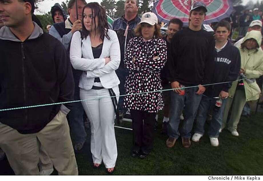 onlocationATT008_mk.jpg  White suit, rain and no umbrella - On Location AT&T golf tournament Pebble Beach.  Mike Kepka / The Chronicle MANDATORY CREDIT FOR PHOTOG AND SF CHRONICLE/ -MAGS OUT Photo: Mike Kepka