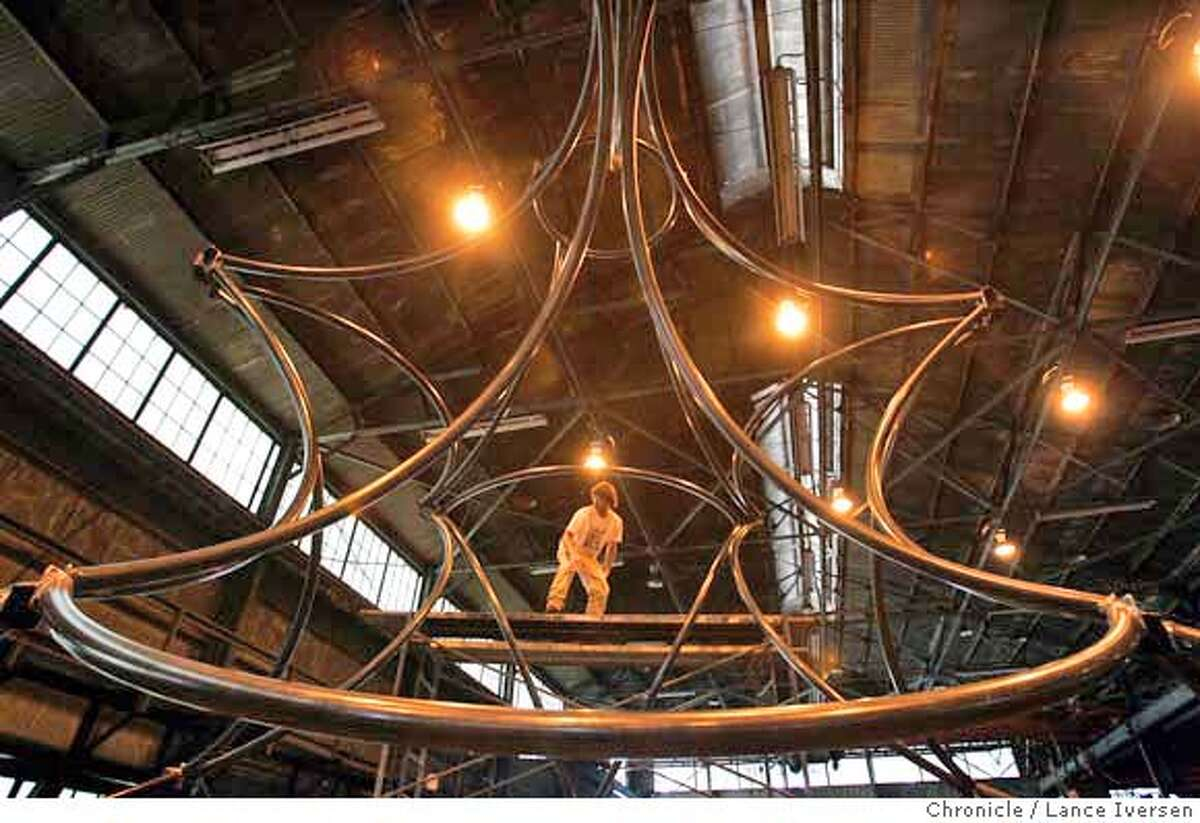 BURNINGKIDSXX_0008_LI.JPG Andrew Harth (cq) from Berkeley works on his yet to be named steal structure that will be used as a children�s gathering point at Burning Man. Burning Man is earning a new reputation as a sort of desert Disneyland as more and more families from the Bay Area and beyond are hauling the kiddies out to Black Rock City. It was probably inevitable. The Burners, who got their start on a San Francisco beach, are growing up and having kids but don't want to stop frolicking in the desert. They say it's a great place for kids to express themselves and experience interactive art, as long as they can manage the heat, the dust storms and the occasional downpour. And they say the sex and drugs, while certainly there, are avoidable. And seeing naked people never really hurt anyone. By Lance Iversen/San Francisco Chronicle