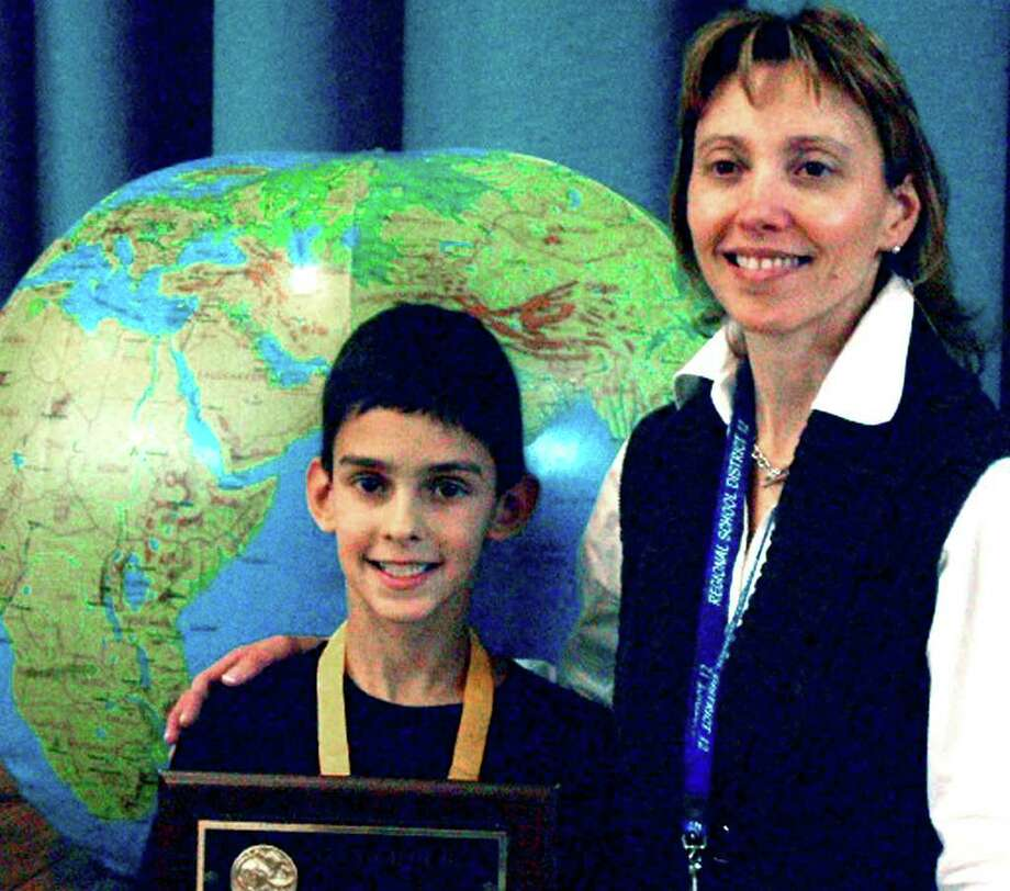 SPECTRUM/Dominic Perachi, a fifth-grade student at Washington Primary Schol, poses recently for a photo with his new principal, Emily Judd, after capturing first place in the school's annual geography bee. January 2012  Courtesy of Washington Primary School Photo: Contributed Photo